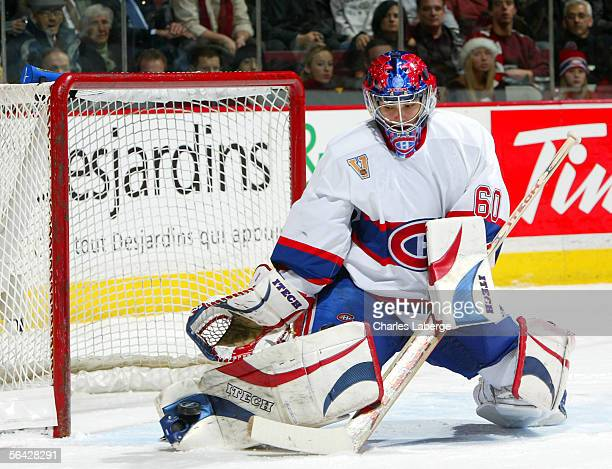 Goalie Jose Theodore of the Montreal Canadiens makes a pad save against the Phoenix Coyotes during NHL action at the Bell Centre on December 13 2005...