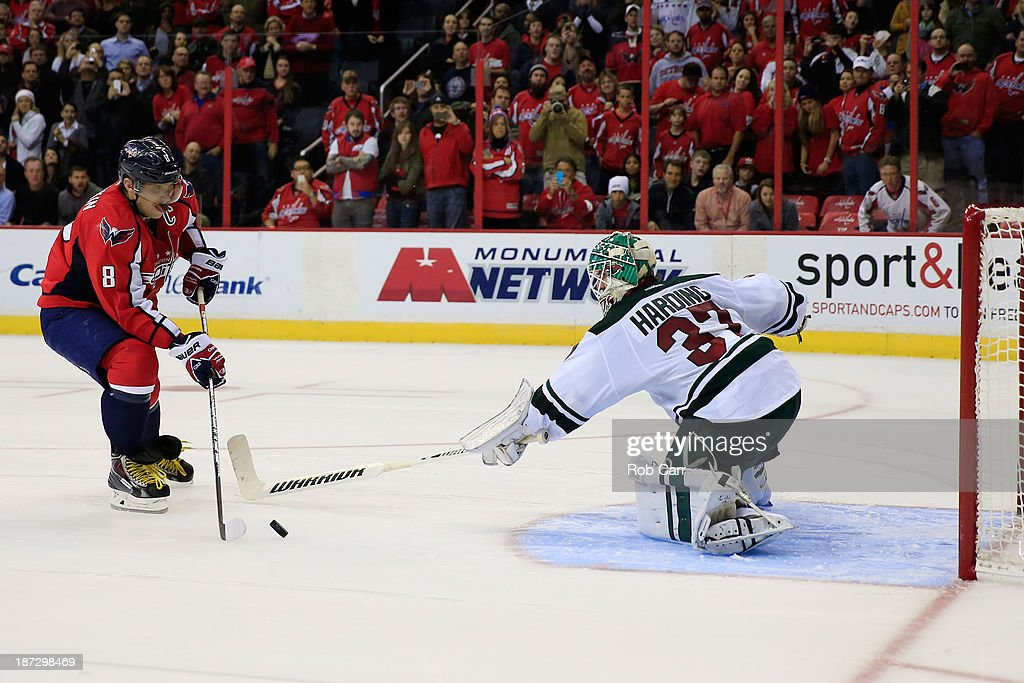 Goalie <a gi-track='captionPersonalityLinkClicked' href=/galleries/search?phrase=Josh+Harding&family=editorial&specificpeople=700587 ng-click='$event.stopPropagation()'>Josh Harding</a> #37 of the Minnesota Wild stops a shot by Alex Ovechkin #8 of the Washington Capitals during the Capitals 3-2 shootout win at Verizon Center on November 7, 2013 in Washington, DC.