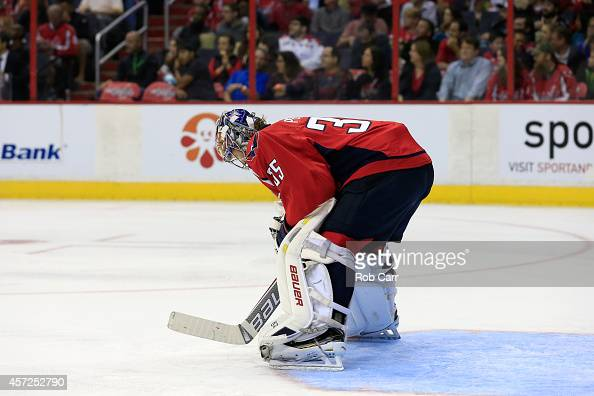 Goalie Justin Peters of the Washington Capitals follows the puck against the San Jose Sharks during the second period at Verizon Center on October 14...