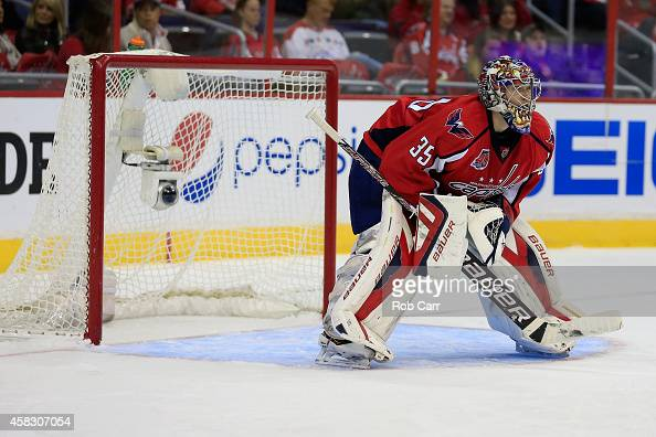 Goalie Justin Peters of the Washington Capitals looks on during the second period against the Arizona Coyotes at Verizon Center on November 2 2014 in...