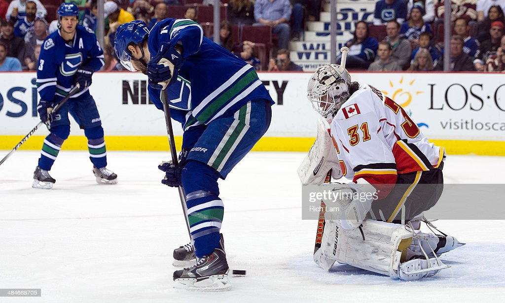 Goalie Karri Ramo #31 of the Calgary Flames stops a redirected shot y Ryan Kesler #17 of the Vancouver Canucks during the second period in NHL action on April 13, 2014 at Rogers Arena in Vancouver, British Columbia, Canada.