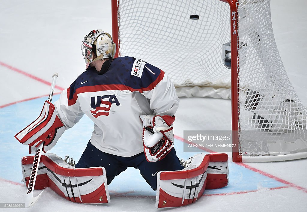 US goalie Keith Kinkaid lets the puck into his net during the group B preliminary round game USA vs Canada at the 2016 IIHF Ice Hockey World Championship in St. Petersburg on May 6, 2016. / AFP / ALEXANDER