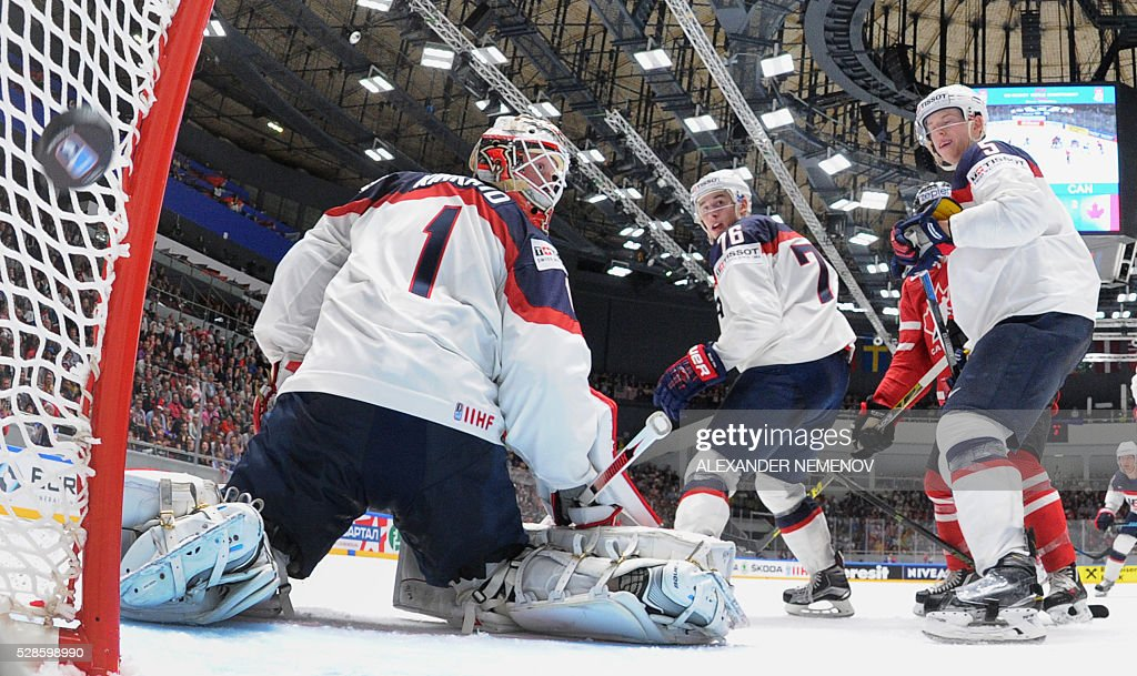 US goalie Keith Kinkaid lets the puck into his net during the group B preliminary round game USA vs Canada at the 2016 IIHF Ice Hockey World Championship in St. Petersburg on May 6, 2016. / AFP / POOL / ALEXANDER