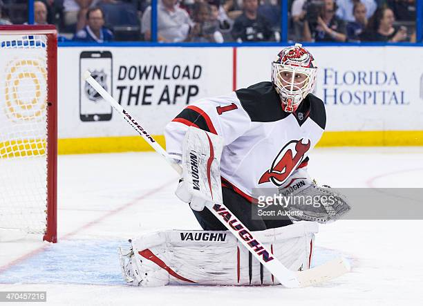 Goalie Keith Kinkaid of the New Jersey Devils skates against the Tampa Bay Lightning during the third period at the Amalie Arena on April 9 2015 in...