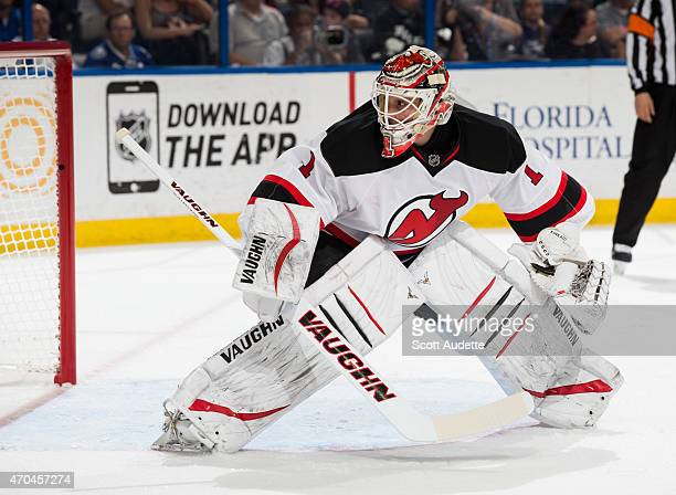 Goalie Keith Kinkaid of the New Jersey Devils skates against the Tampa Bay Lightning during the first period at the Amalie Arena on April 9 2015 in...