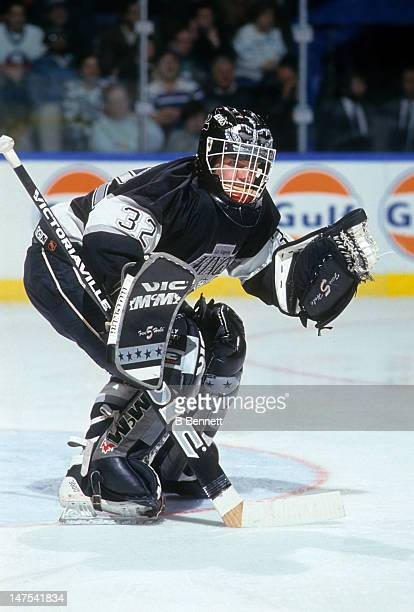 Goalie Kelly Hrudey of the Los Angeles Kings defends the net during an NHL game against the New York Islanders circa 1991 at the Nassau Coliseum in...