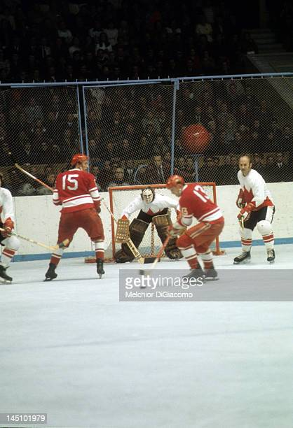 Goalie Ken Dryden and Gary Bergman of Canada defend the net as Boris Mikhailov and Alexander Yakushev of the Soviet Union look to score during the...