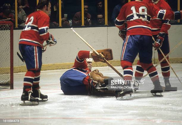 NEW YORK NY DECEMBER 26 Goalie Ken Dryden of the Montreal Canadiens covers up the puck during an NHL game against the New York Rangers on December 26...