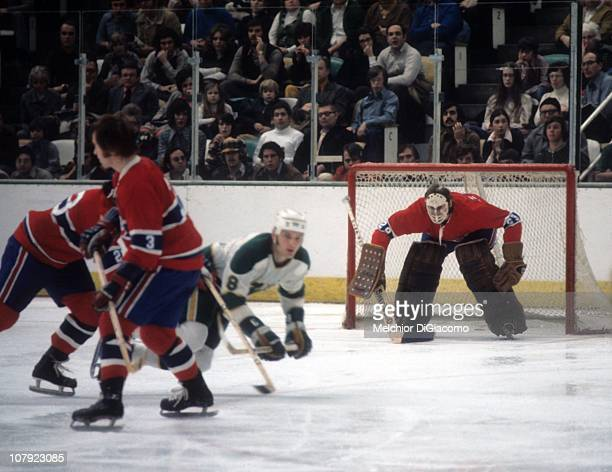 Goalie Ken Dryden of the Montreal Canadiens defends the net as teammates Bob Gainey and Brian Engblom fend off KentErik Andersson of the Minnesota...