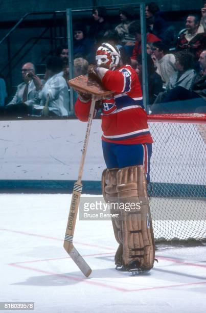 Goalie Ken Dryden of the Montreal Canadiens leans on his goalie stick during an NHL game against the California Golden Seals circa 1976 at the...
