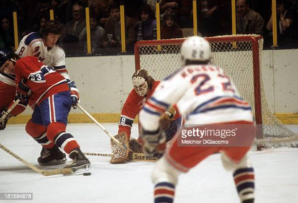 NEW YORK NY 1972 Goalie Ken Dryden of the Montreal Canadiens looks to make the save as his teammate Bob Murdoch battles for position with Steve...