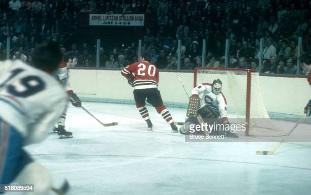 Goalie Ken Dryden of the Montreal Canadiens makes the save as Cliff Koroll of the Chicago Blackhawks skates by the net during a 1971 Stanley Cup...