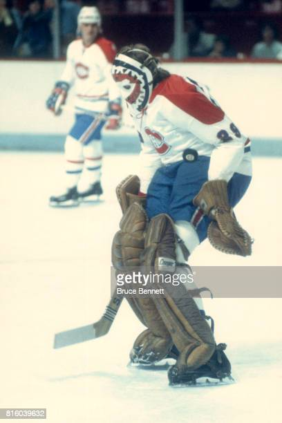Goalie Ken Dryden of the Montreal Canadiens makes the save during warmups before an NHL game circa 1976 at the Montreal Forum in Montreal Quebec...