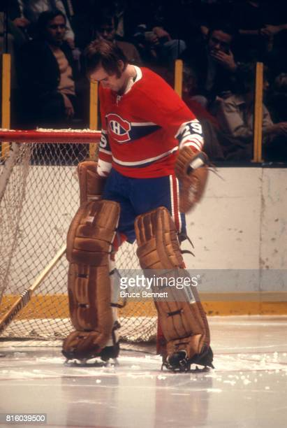 Goalie Ken Dryden of the Montreal Canadiens roughs up his crease before the start of a period during an NHL game against the New York Rangers on...