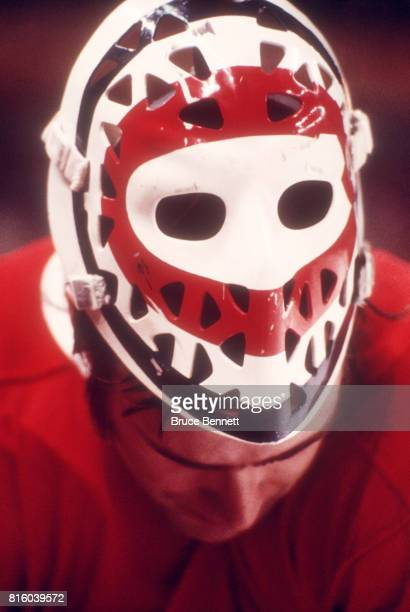Goalie Ken Dryden of the Montreal Canadiens skates on the ice as his mask sits on top of his head during an NHL game circa 1976