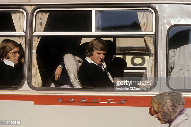 Goalie Ken Dryden with glasses and Vic Hadfield of Canada in black sweater ride the bus between games with the Soviet Union during the 1972 Summit...