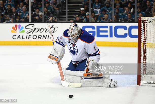 Goalie Laurent Brossoit of the Edmonton Oilers blocks a shot against the San Jose Sharks during the second period in Game Four of the Western...