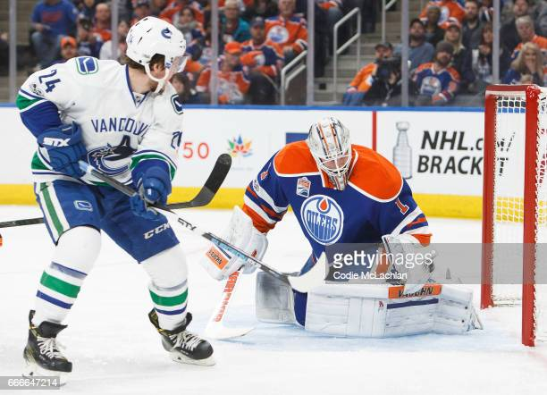 Goalie Laurent Brossoit of the Edmonton Oilers makes a save against Reid Boucher of the Vancouver Canucks in the first period on April 9 2017 at...