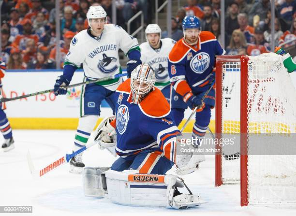 Goalie Laurent Brossoit of the Edmonton Oilers makes a save against the Vancouver Canucks in the first period on April 9 2017 at Rogers Place in...