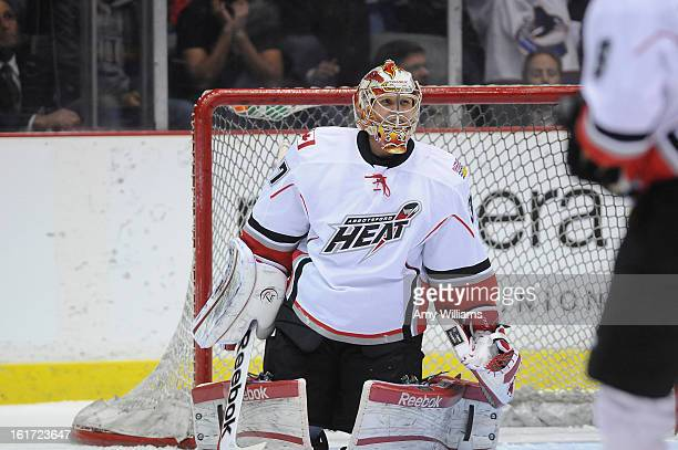 Goalie Leland Irving of the Abbotsford Heat makes a save on the Chicago Wolves at Abbotsford Entertainment and Sports Centre on January 11 2013 in...