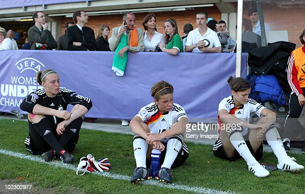Goalie Lena Nuding of Germany Melanie Leupolz of Germany and Luisa Wensing of Germany look dejected after losing the UEFA European Women's Under 17...