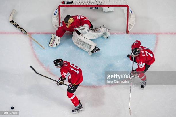 Goalie Leonardo Genoni #16 Raphael Diaz and Tanner Richard defends during the Ice Hockey World Championship between Switzerland and Finland at...