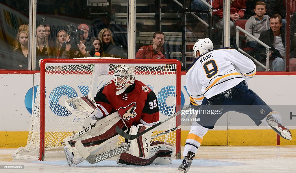 Goalie Louis Domingue #35 of the Arizona Coyotes deflects the shot of Evander Kane #9 of the Buffalo Sabres over the cross bar during the second period at Gila River Arena on January 18, 2016 in Glendale, Arizona.