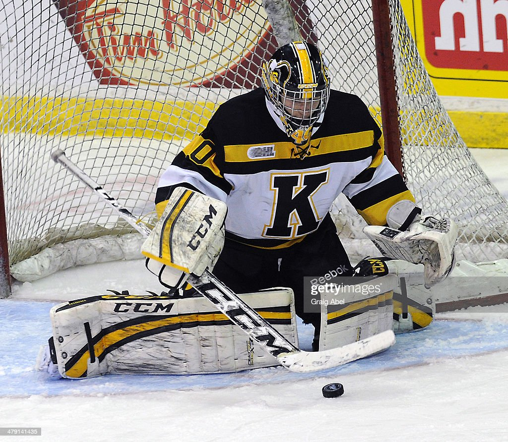 Goalie Lucas Peressini #40 of the Kingston Frontenacs stops a shot against the Mississauga Steelheads during game action on March 16, 2014 at the Hershey Centre in Mississauga, Ontario, Canada.