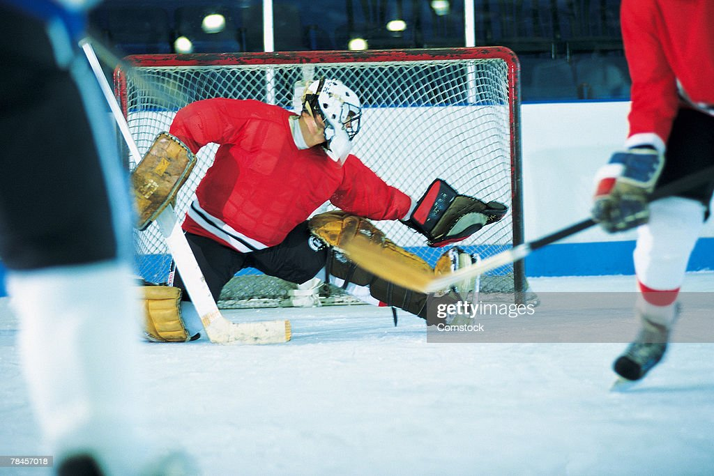 Goalie making save in ice hockey game