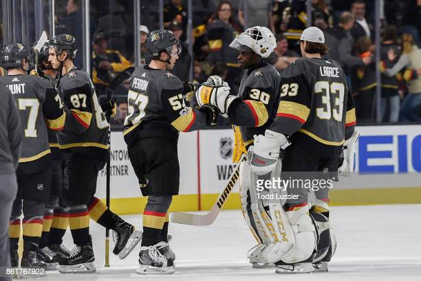 Goalie Malcolm Subban is congratulated by his teammate David Perron of the Vegas Golden Knights after defeating the Boston Bruins during the game at...