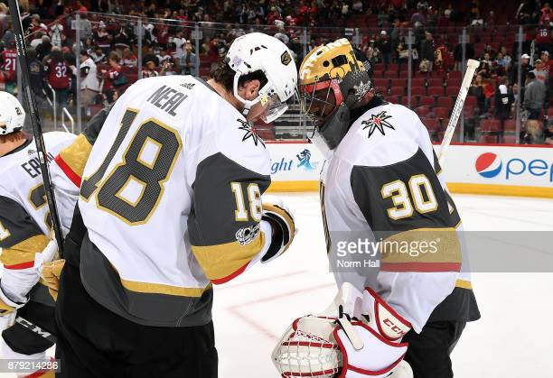 Goalie Malcolm Subban of the Vegas Golden Knights is congratulated by teammate James Neal after a 42 victory against the Arizona Coyotes at Gila...