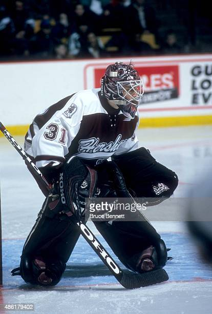 Goalie Marc Denis of the Hershey Bears defends the net during an AHL game in March 1999