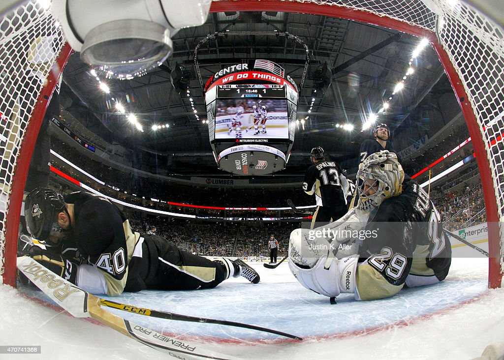 Goalie <a gi-track='captionPersonalityLinkClicked' href=/galleries/search?phrase=Marc-Andre+Fleury&family=editorial&specificpeople=233779 ng-click='$event.stopPropagation()'>Marc-Andre Fleury</a> #29 and <a gi-track='captionPersonalityLinkClicked' href=/galleries/search?phrase=Maxim+Lapierre&family=editorial&specificpeople=718385 ng-click='$event.stopPropagation()'>Maxim Lapierre</a> #40 of the Pittsburgh Penguins react after giving up the game-winning overtime goal to <a gi-track='captionPersonalityLinkClicked' href=/galleries/search?phrase=Kevin+Hayes+-+Ice+Hockey+Player&family=editorial&specificpeople=13635523 ng-click='$event.stopPropagation()'>Kevin Hayes</a> (not pictured) of the New York Rangers in Game Four of the Eastern Conference Quarterfinals during the 2015 NHL Stanley Cup Playoffs at Consol Energy Center on April 22, 2015 in Pittsburgh, Pennsylvania.