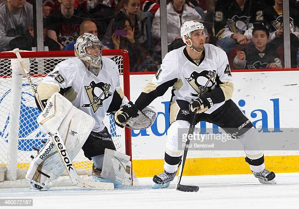 Goalie MarcAndre Fleury of the Pittsburgh Penguins defends his goal with teammate Robert Bortuzzo in an NHL hockey game against the New Jersey Devils...