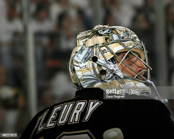 Goalie MarcAndre Fleury of the Pittsburgh Penguins looks up at the crowd during Game Three of the 2009 Stanley Cup Finals against the Detroit Red...