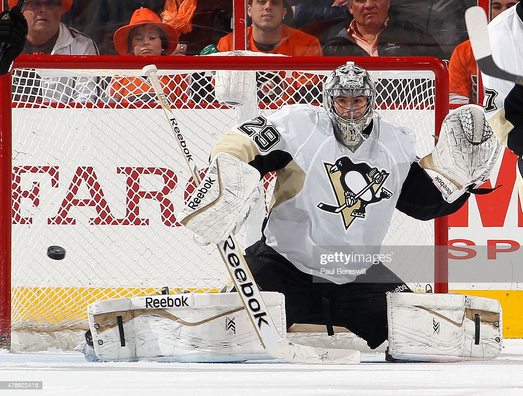 Goalie <a gi-track='captionPersonalityLinkClicked' href=/galleries/search?phrase=Marc-Andre+Fleury&family=editorial&specificpeople=233779 ng-click='$event.stopPropagation()'>Marc-Andre Fleury</a> #29 of the Pittsburgh Penguins makes a save in the third period of an NHL hockey game against the Philadelphia Flyers at Wells Fargo Center on March 15, 2014 in Philadelphia, Pennsylvania.