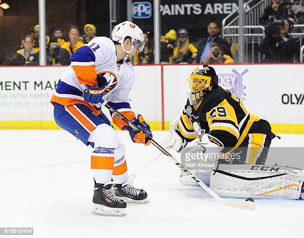 Goalie MarcAndre Fleury of the Pittsburgh Penguins makes a save on Shane Prince of the New York Islanders at PPG PAINTS Arena on October 27 2016 in...