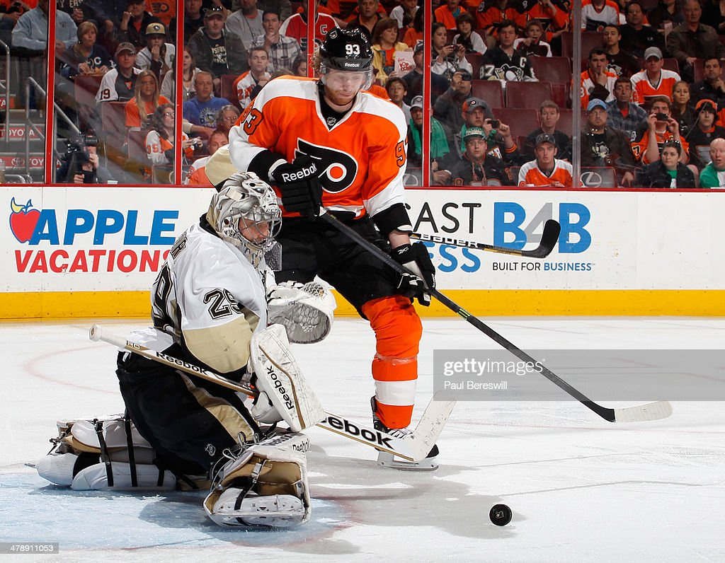 Goalie Marc-Andre Fleury #29 of the Pittsburgh Penguins stops a shot in front of Jakub Voracek #93 of the Philadelphia Flyers during the second period of an NHL hockey game at Wells Fargo Center on March 15, 2014 in Philadelphia, Pennsylvania.