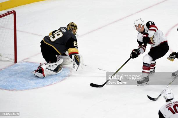 Goalie MarcAndre Fleury of the Vegas Golden Knights blocks a shot from Derek Sapan of the Arizona Coyotes at TMobile Arena on October 10 2017 in Las...