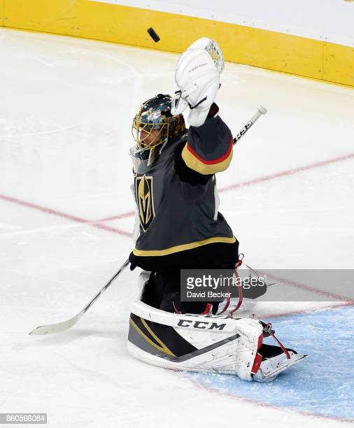 Goalie MarcAndre Fleury of the Vegas Golden Knights deflects the puck against the Arizona Coyotes at TMobile Arena on October 10 2017 in Las Vegas...