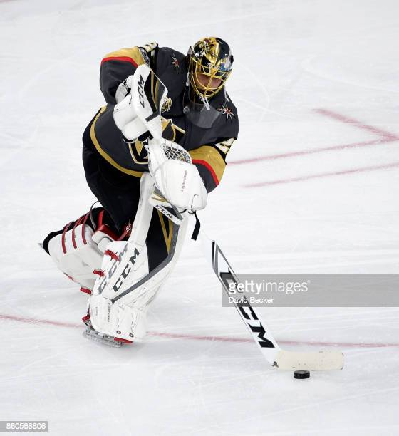 Goalie MarcAndre Fleury of the Vegas Golden Knights skates withthe puck against the Arizona Coyotes at TMobile Arena on October 10 2017 in Las Vegas...