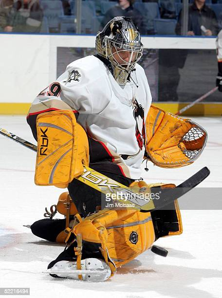 Goalie MarcAndre Fleury of the WilkesBarre/Scranton Penguins makes a save during warmups before the game against the Bridgeport Sound Tigers on...