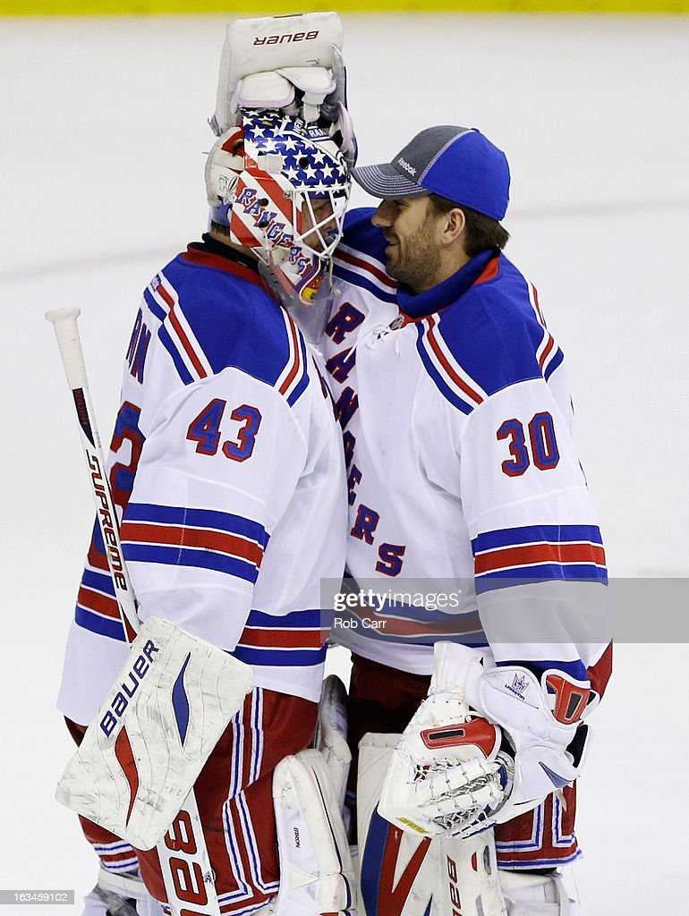 Goalie <a gi-track='captionPersonalityLinkClicked' href=/galleries/search?phrase=Martin+Biron&family=editorial&specificpeople=203146 ng-click='$event.stopPropagation()'>Martin Biron</a> #43 of the New York Rangers is congratulated by <a gi-track='captionPersonalityLinkClicked' href=/galleries/search?phrase=Henrik+Lundqvist&family=editorial&specificpeople=217958 ng-click='$event.stopPropagation()'>Henrik Lundqvist</a> #30 after the Rangers defeated the Washington Capitals 4-1 at Verizon Center on March 10, 2013 in Washington, DC.