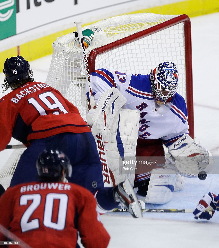 Goalie <a gi-track='captionPersonalityLinkClicked' href=/galleries/search?phrase=Martin+Biron&family=editorial&specificpeople=203146 ng-click='$event.stopPropagation()'>Martin Biron</a> #43 of the New York Rangers makes a save on a shot by Nicklas Backstrom #19 of the Washington Capitals during the third period at Verizon Center on March 10, 2013 in Washington, DC.