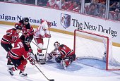 Goalie Martin Brodeur of the makes the save as his teammates Scott Stevens Scott Niedermayer and Tom Chorske come to his aide as Ray Sheppard of the...