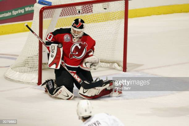 Goalie Martin Brodeur of the New Jersey Devils makes a save against the Mighty Ducks of Anaheim in game four of the 2003 Stanley Cup Finals June 2...