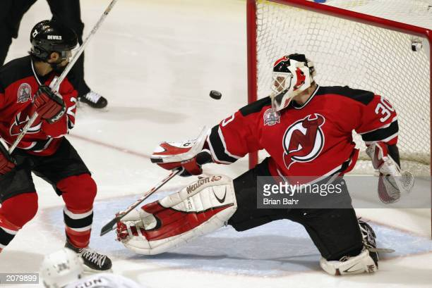 Goalie Martin Brodeur of the New Jersey Devils makes a save on goal against the Mighty Ducks of Anaheim in game four of the 2003 Stanley Cup Finals...
