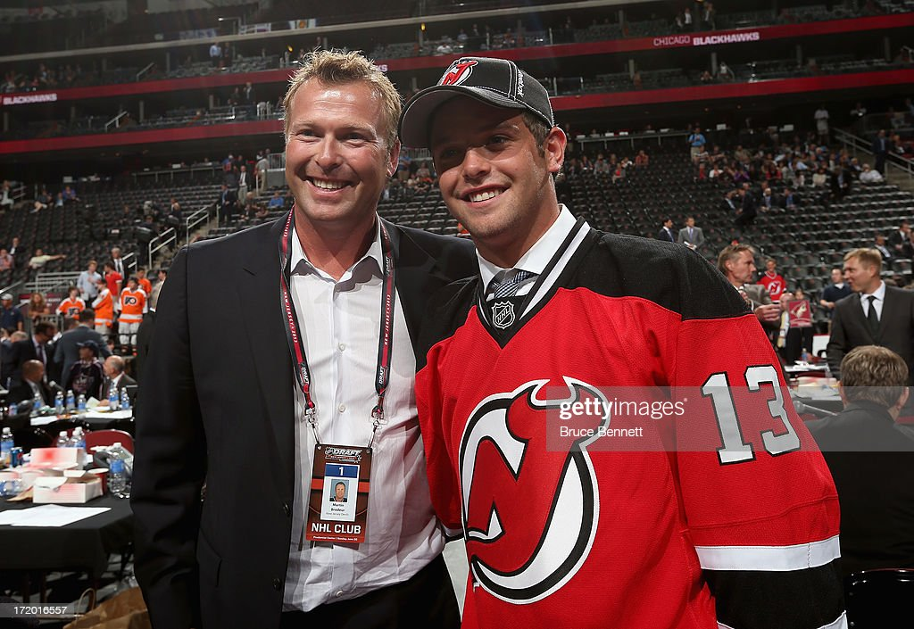 Goalie Martin Brodeur of the New Jersey Devils poses for a photo with his son Anthony Brodeur after Anthony was drafted overall in the seventh round...