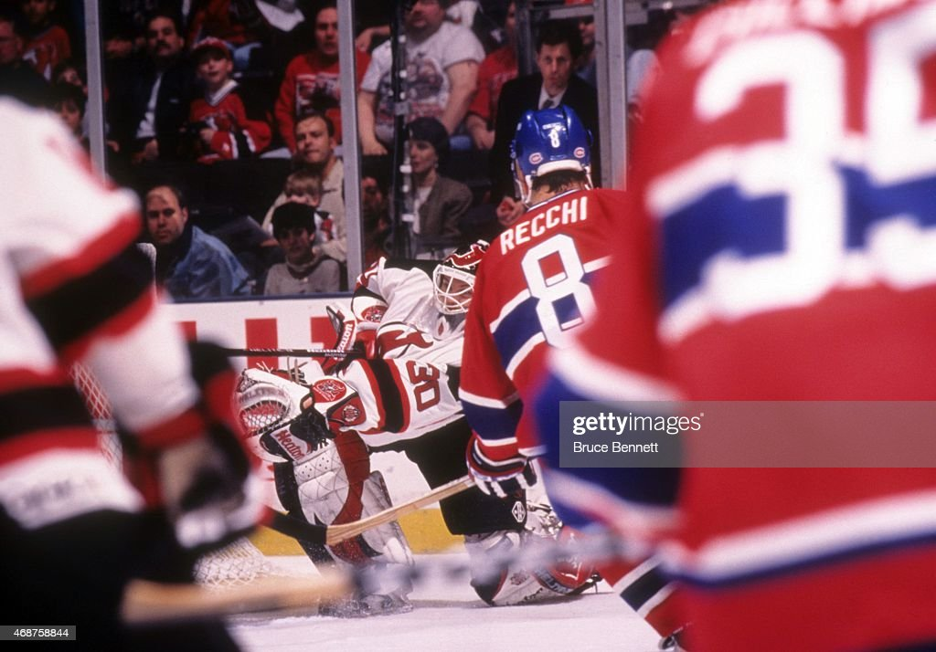 Goalie Martin Brodeur of the New Jersey Devils shoots the puck down the ice to score his first NHL goal during Game 1 of the 1997 Conference...