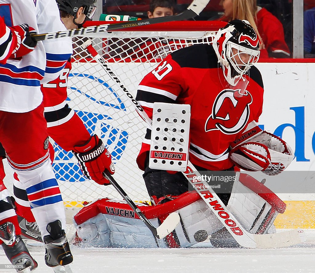 Goalie <a gi-track='captionPersonalityLinkClicked' href=/galleries/search?phrase=Martin+Brodeur&family=editorial&specificpeople=201594 ng-click='$event.stopPropagation()'>Martin Brodeur</a> #30 of the New Jersey Devils stops a shot by the New York Rangers in the second period of an NHL hockey game at Prudential Center on February 5, 2013 in Newark, New Jersey.
